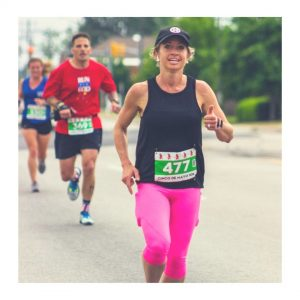 woman running in a race